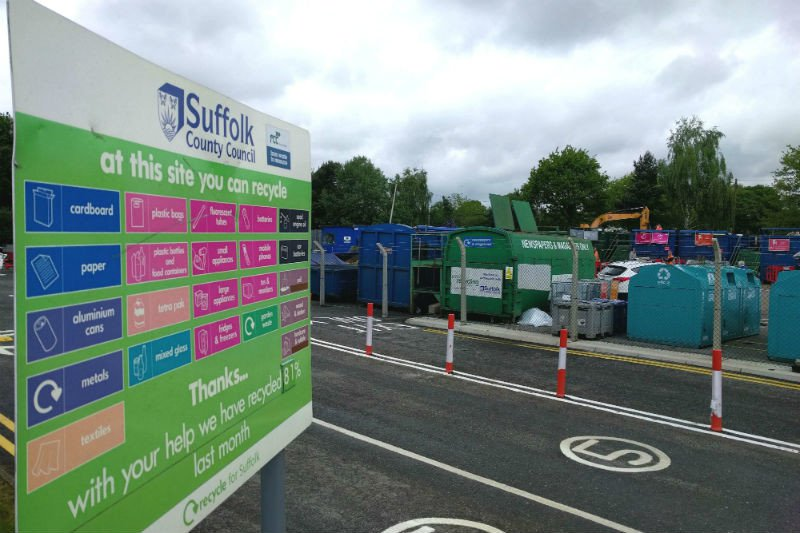 Entrance of Foxhall recycling centre with board and bins