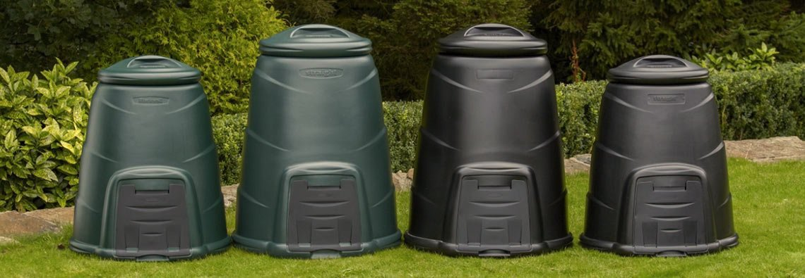 4 compost bins in a garden