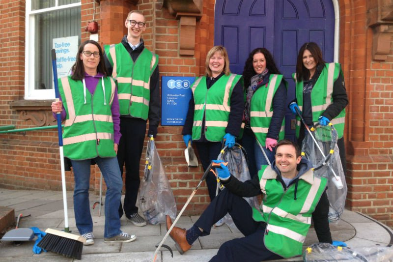 Felixstowe litter picking volunteers outside a brick building