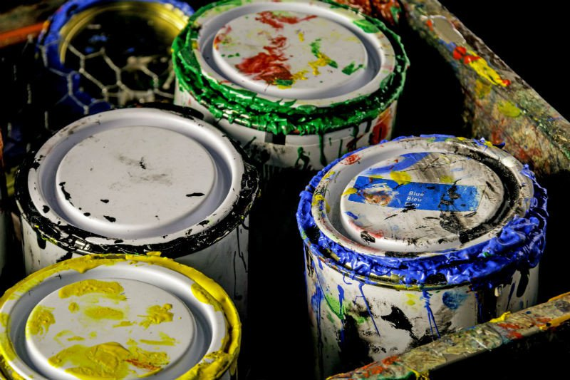 Collection of messy paint cans